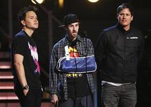 <p>Blink-182 band members Mark Hoppus (L), Travis Barker (C), and Tom DeLonge present the Best Rock Album at the 51st annual Grammy Awards in Los Angeles, February 8, 2009. REUTERS/Lucy Nicholson</p>