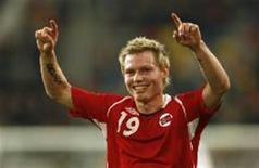 <p>Jogador norueguês Bjorn Helge Riise celebra o único gol de seu time na vitória sobre a Alemanha, em jogo amistoso disputado em Berlim nesta quarta-feira. February 11, 2009. REUTERS/Ina Fassbender (GERMANY)</p>