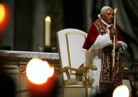 Pope Benedict XVI holds a candle as he attends a ceremony to mark the World Day of the Sick in Saint Peter's Basilica at the Vatican February 11, 2009. REUTERS/Alessia Pierdomenico