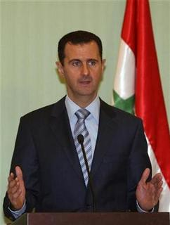 Syria's President Bashar al-Assad speaks during a news conference with his French counterpart Nicolas Sarkozy in Damascus in this January 6, 2009 file photo. REUTERS/Khaled al-Hariri (SYRIA)
