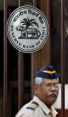 A policeman stands guard at the entrance of the headquarters of the Reserve Bank of India in Mumbai January 27, 2009. State-run Punjab National Bank expects the central bank to further cut rates as inflation moderates, its chairman said Friday, in order to push banks to cut their own lending rates. REUTERS/Arko Datta