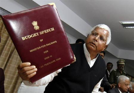 India's Railway Minister Lalu Prasad Yadav holds the speech for the 2009-10 railway budget in New Delhi February 12, 2009.  REUTERS/Adnan Abidi