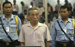 <p>Former Khmer Rouge S-21 prison chief Kaing Guek Eav, better known as Duch, stands in a courtroom during a pre-trial in Phnom Penh December 5, 2008. REUTERS/Tang Chhinsothy/Pool</p>