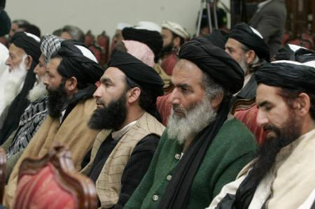 Delegation members of Pakistani Islamist leader Soofi Mohammad from the Swat valley attend a meeting with government officials, political and religious leaders in Peshawar February 16, 2009. REUTERS/Ali Imam