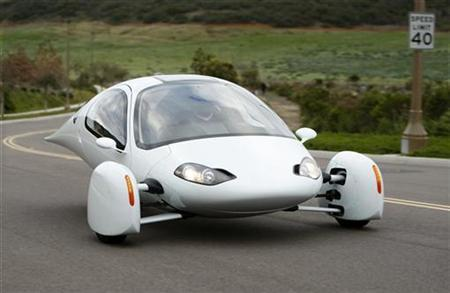 The Aptera 2e electric vehicle is driven down a road in Carlsbad, California February 13, 2009. REUTERS/Mike Blake