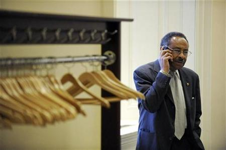 Senator Roland Burris (D-IL) speaks on the phone while waiting for a Democratic caucus meeting about a compromise deal on President Barack Obama's economic stimulus bill at the US Capitol in Washington, February 6, 2009. REUTERS/Jonathan Ernst