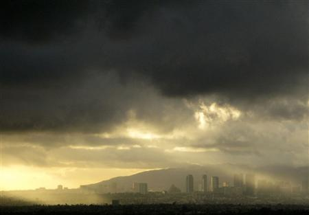 Rain clouds hang over the West Los Angeles area, February 13, 2009. REUTERS/Sam Mircovich