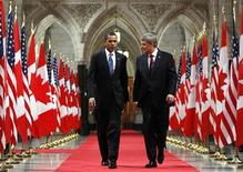 <p>President Barack Obama (L) and Prime Minister Stephen Harper walk down the Hall of Honour on the way to a news conference on Parliament Hill in Ottawa, February 19, 2009. REUTERS/Chris Wattie</p>