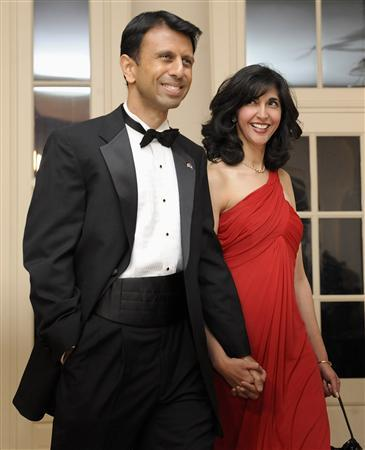 Louisiana Governor Bobby Jindal (L) arrives with his wife Supriya Jindal (R) for a dinner held for the National Governors Association by U.S. President Barack Obama at the White House in Washington, February 22, 2009. REUTERS/Jonathan Ernst