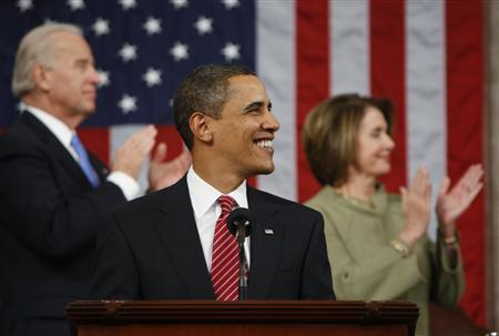 U.S. President Barack Obama smiles during his address before a joint session of Congress in Washington, February 24, 2009. Vice President Joe Biden (L) and Speaker of the House Nancy Pelosi applaud in the background. REUTERS/Pablo Martinez Monsivais