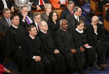 Supreme Court justices listen as President Barack Obama gives his primetime address to a joint session of the Congress on Capitol Hill, February 24, 2009. REUTERS/Kevin Lamarque