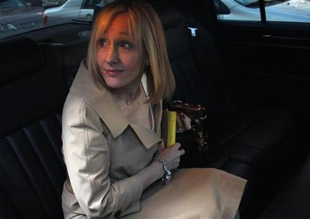 J.K. Rowling, author of the Harry Potter book series, sits in her car after leaving the U.S. District Court in New York April 15, 2008. REUTERS/Joshua Lott