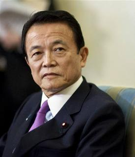 Japan's Prime Minister Taro Aso meets with U.S. President Barack Obama in the Oval Office of the White House in Washington, DC February 24, 2009, file photo. REUTERS/Joshua Roberts