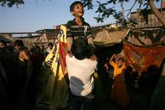 """<p>Azharuddin Ismail (top) who acted in the film """"Slumdog Millionaire"""", celebrates with a friend outside his house in Mumbai February 26, 2009. Ismail came back on Thursday after attending the 81st Academy Awards. REUTERS/Arko Datta</p>"""