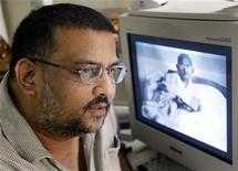<p>Tushar Gandhi, great grandson of India's Mahatma Gandhi, speaks to Reuters in Bombay August 4, 2003. REUTERS/Sherwin Crasto</p>