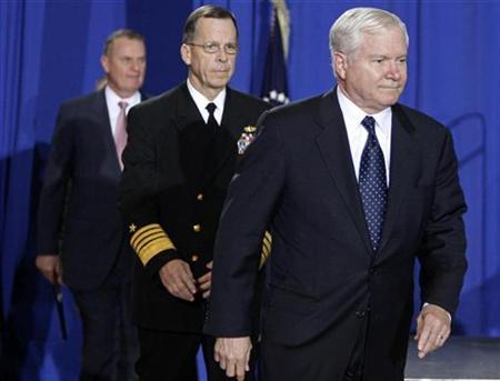 U.S. Secretary of Defense Robert Gates (R), Chairman of the Joint Chiefs of Staff Admiral Mike Mullen (C) and Assistant to the President for National Security Affairs General James Jones (USMC Ret.) enter before the arrival of President Barack Obama at Camp Lejeune, North Carolina, February 27, 2009. REUTERS/Jim Young