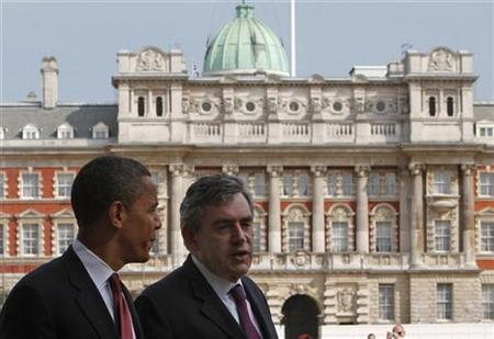 In this file photo, Prime Minister Gordon Brown (R) walks with U.S. Democratic presidential candidate Senator Barack Obama through Horseguards Parade behind 10 Downing Street in London, July 26, 2008. REUTERS/Jim Young