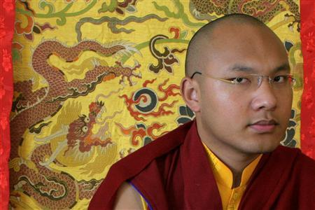 Karmapa Lama, the third highest ranking Lama, pauses during an interview with Reuters in the northern Indian hill town of Dharamsala March 2, 2009. He is a ''living Buddha'' with an iPod, the 23-year-old possible successor to the Dalai Lama who may bridge the gap between Tibet's elder leaders and both an alienated Tibetan youth and a suspicious China. REUTERS/Abhishek Madhukar