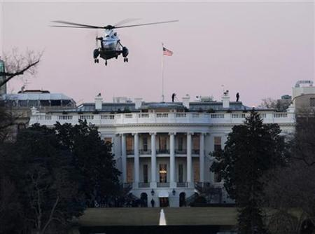 Marine One arrives at the White House to pick up President Barack Obama for the first time, February 5, 2009. REUTERS/Jason Reed