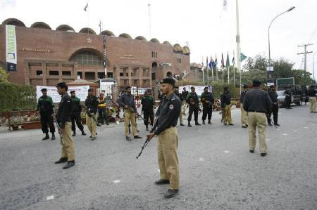 Pakistan policemen stand guard outside the Gaddafi stadium after a shooting in Lahore March 3, 2009. REUTERS/Mohsin Raza