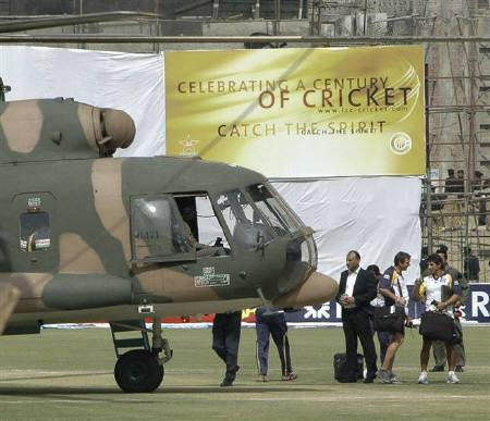 Sri Lankan cricket team members prepare to board a Pakistani military helicopter at the Gaddafi stadium after a shooting in Lahore March 3, 2009. REUTERS/Syed Mujtaba