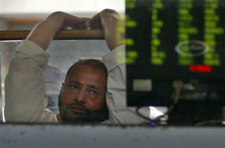 A stockbroker sits inside the trading hall during trading session at the Karachi Stock Exchange in this August 2008 file photo. The dwindling number of foreign investors left in Pakistan must wonder whether it's worth it after militants targeted the Sri Lankan cricket team in Lahore. REUTERS/Athar Hussain