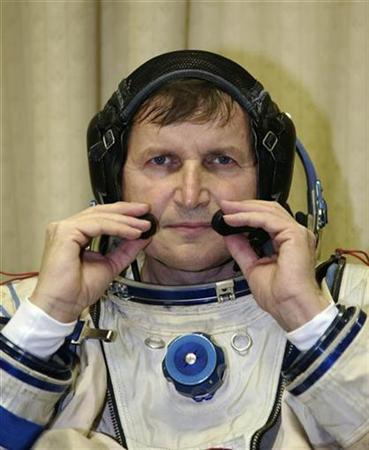 Entrepreneur Charles Simonyi of the U.S. puts on his space suit at the Star City space centre outside Moscow, where he is being tested on his readiness to travel to the International Space Station, March 4, 2009. REUTERS/Sergei Remezov