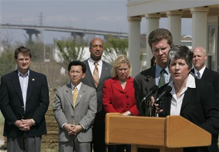 United States Homeland Security Director Janet Napolitano speaks as Housing and Urban Development Secretary Shaun Donovan and local elected officials look on following a tour of recovery efforts from Hurricane Katrina in New Orleans, Louisiana March 5, 2009. REUTER/Lee Celano