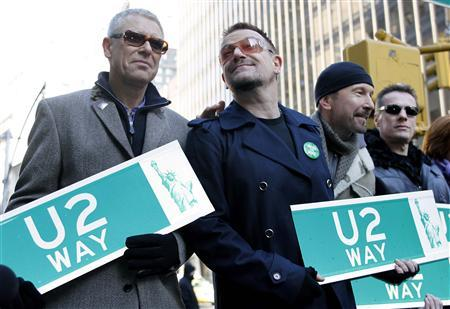 Members of the rock group U2, (from L) Adam Clayton, Bono, Edge and Larry Mullen hold street signs after a portion of West 53rd Street was renamed U2 Way in New York March 3, 2009. U2's new album No Line On The Horizon was released today. REUTERS/Gary Hershorn