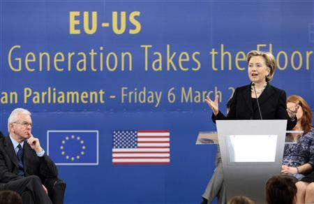 Secretary of State Hillary Clinton (R) delivers a speech in front of European Parliament President Hans-Gert Poettering (L) during a town hall meeting with people at the EU Parliament in Brussels March 6, 2009. REUTERS/Sebastien Pirlet