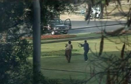 A video grab shows gunmen firing in the direction of a police vehicle in Lahore March 3, 2009. REUTERS/SAMAA via Reuters TV