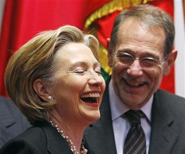 U.S. Secretary of State Hillary Rodham Clinton (L) and EU foreign policy chief Javier Solana (R) share a laugh at the end of a meeting at the European Council headquarters in Brussels March 6, 2009. REUTERS/Yves Herman