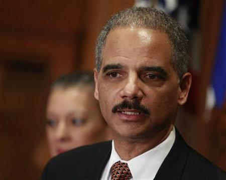 Eric Holder is pictured after being sworn in as U.S. Attorney General at the Justice Department in Washington February 3, 2009. REUTERS/Jason Reed