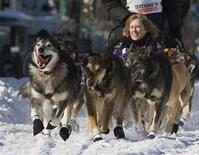 <p>Reigning two-time Iditarod champion Lance Mackey and his team charge down the trail shortly after leaving the gate during the ceremonial start of the 2009 Iditarod Race in downtown Anchorage, Alaska March 7, 2009. REUTERS/Nathaniel Wilder</p>