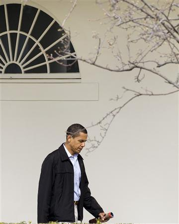 President Barack Obama walks out of the Oval Office before departing for the presidential retreat in Maryland, March 7, 2009. REUTERS/Larry Downing