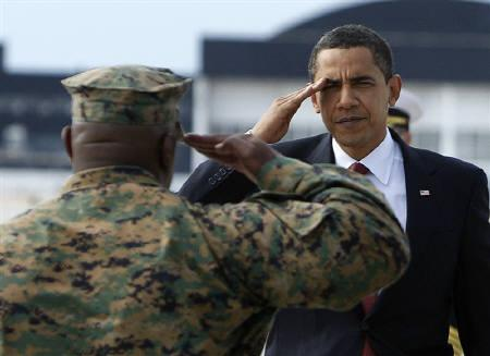 U.S. President Barack Obama exchanges salutes with a Marine as he prepares to board Air Force One at Cherry Point Marine Corps Air Station (MCAS), North Carolina, in this February 27, 2009 file photo.    REUTERS/Jim Young/Files
