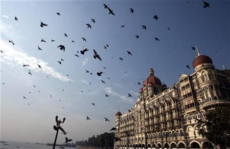 Pigeons fly around Taj Mahal hotel in Mumbai December 22, 2008. REUTERS/Arko Datta