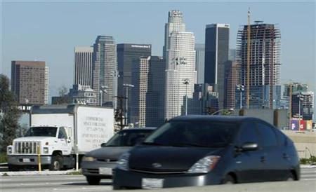 A Toyota Prius hybrid car drives past downtown Los Angeles on the 10 freeway, January 27, 2009. REUTERS/Lucy Nicholson