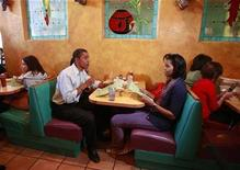 <p>Then-U.S. Democratic presidential nominee Senator Barack Obama (D-IL) and his wife Michelle sit in a booth for a family meal with their daughters, Malia and Sasha (both obscured), at Jorge's Sombrero Mexican restaurant in Pueblo, Colorado in this file photo from November 1, 2008. REUTERS/Jason Reed</p>