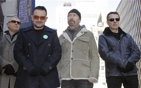 Members of the rock group U2, Adam Clayton (L), Bono (2nd L), Edge (2nd R) and Larry Mullen (R), attend a ceremony where a portion of West 53rd Street was renamed U2 Way in New York, March 3, 2009. REUTERS/Gary Hershorn