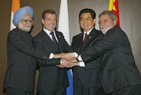 (L-R) Indian Prime Minister Manmohan Singh, Russian President Dmitry Medvedev, Chinese President Hu Jintao and Brazilian President Luiz Inacio Lula da Silva pose for a picture at the Group of Eight (G8) Hokkaido Toyako Summit in northern Japan in this July 2008 file photo. REUTERS/RIA Novosti/Dmitry Astakhov