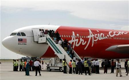 The first leased long haul Malaysian AirAsia X's Airbus A330-300 sits on the tarmac during its inaugural ceremony at the airport in Sepang September 18, 2007. REUTERS/Bazuki Muhammad