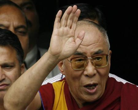 Tibetan spiritual leader Dalai Lama waves as he leaves Lilavati hospital in Mumbai, file photo. REUTERS/Punit Paranjpe