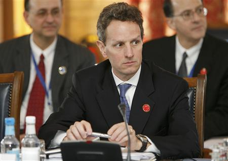 Treasury Secretary Timothy Geithner of the U.S., watches the start of the G20 Finance Minsters meeting at a hotel, near Horsham, in southern England March 14, 2009. REUTERS/Andrew Winning