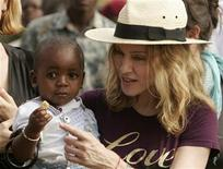 <p>Madonna holds her adopted son, David Banda, at an orphan care centre run by Raising Malawi, a grassroots initiative by Madonna, in Mphendula Village, about 40 km (25 miles) from the capital Lilongwe in this file photo from April 19, 2007.REUTERS/Siphiwe Sibeko</p>