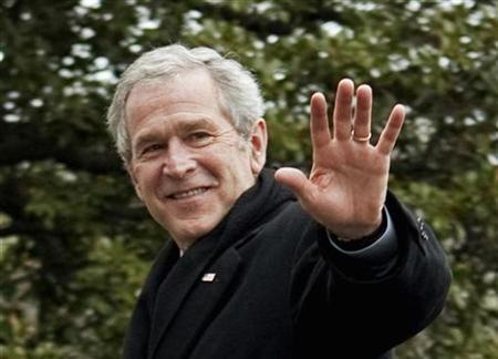 Former U.S. President George W. Bush waves as he returns from Camp David to the White House in Washington, January 18, 2009. REUTERS/Joshua Roberts