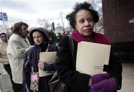 Barbara Morton holds a folder containing her resume as she waits in line to enter a Jobs Fair for unemployed workers hosted by Michigan Works in Wayne, Michigan March 11, 2009. REUTERS/Rebecca Cook