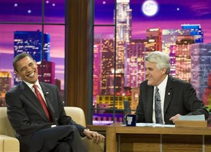 President Barack Obama (L) laughs as he speaks to host Jay Leno on the NBC late night comedy show ''The Tonight Show with Jay Leno'' in Burbank, California March 19, 2009. REUTERS/Larry Downing