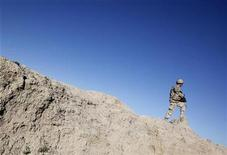 <p>A Canadian soldier patrols during a mission in Afghanistan in this file photo, March 13, 2009. REUTERS/Stefano Rellandini</p>