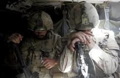 <p>Canadian soldier Master Corporal Chris Jebeaupre (R) from November Company 7th Platoon of the NATO-led coalition rests in an armoured vehicle after a mission in the Taliban stronghold of Zhari district in Kandahar province, southern Afghanistan, March 20, 2009. REUTERS/Stefano Rellandini</p>